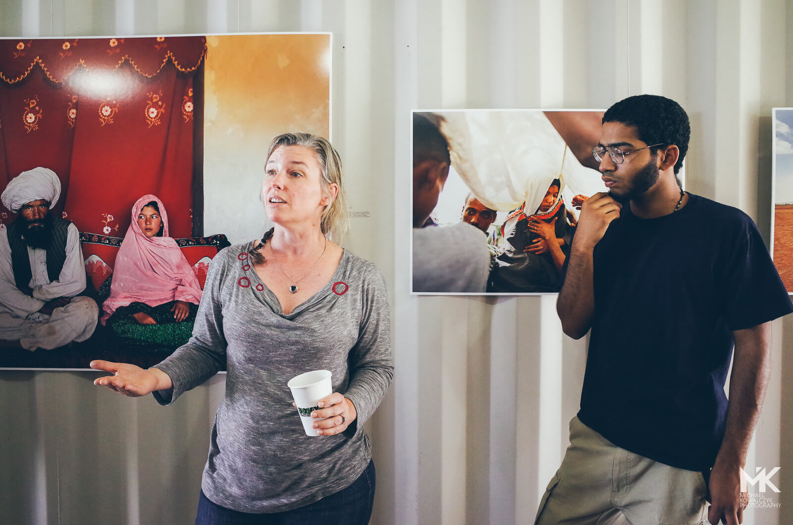 """Stephanie Sinclair discussing her work about child marriage """"Too Young to Wed"""" with the students on Photoville"""