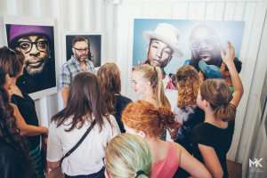 Curious students question Photographer Mark Mann about the celebrities behind the Luminaries portraits in Photoville 2015