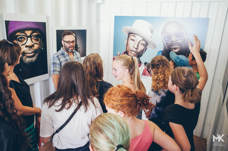 Students asking Mark Mann about his celebrity portraits works on Photoville Education Day 2015