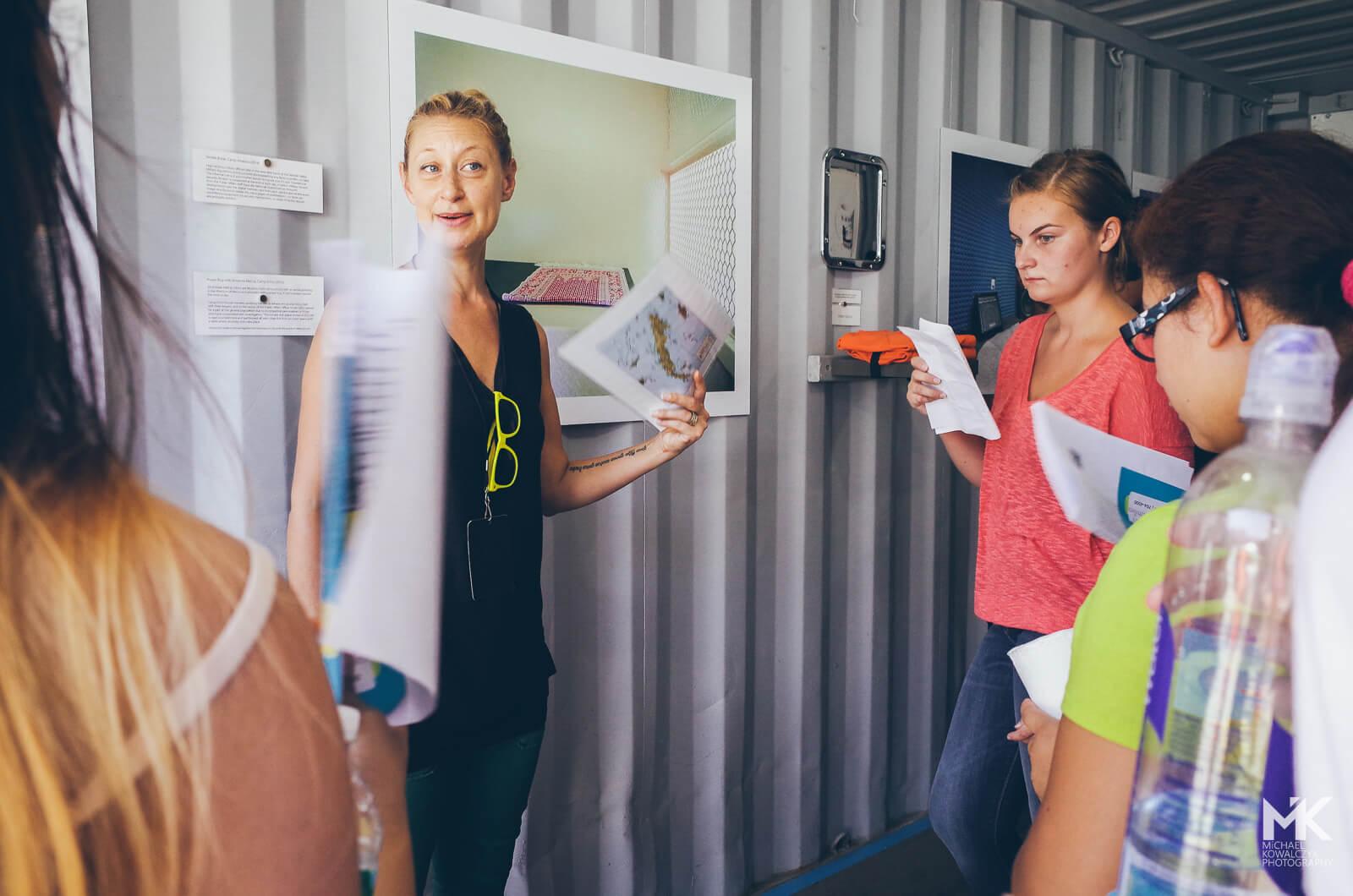 "Photographer Debi Cornwall explains the students her motivation to work on ""Gitmo at Home, Gitmo at Play (Gitmo on Sale)"" in Guantanamo Bay."