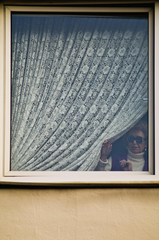 window frame portrait, carnival parade spectator, white stitch curtain
