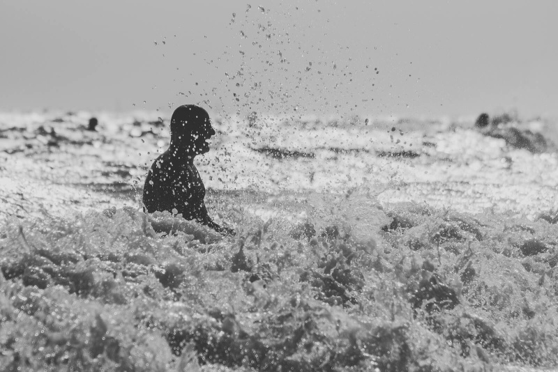 black and white, happy silhouette, ocean waves splashing