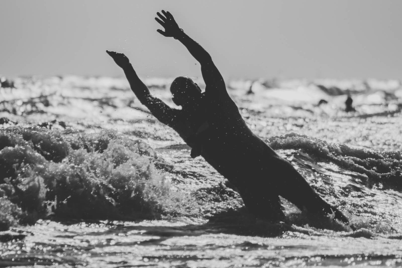 black and white, man jumping silhouette, ocean waves