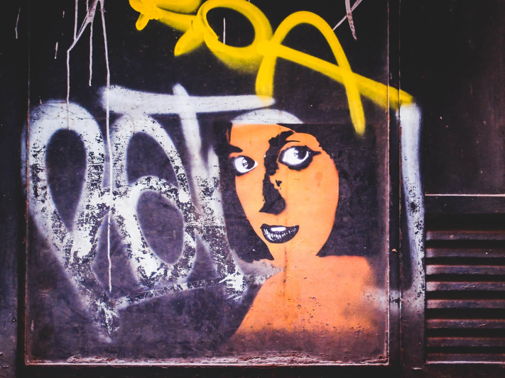Barcelona, orange face woman, street art stencil
