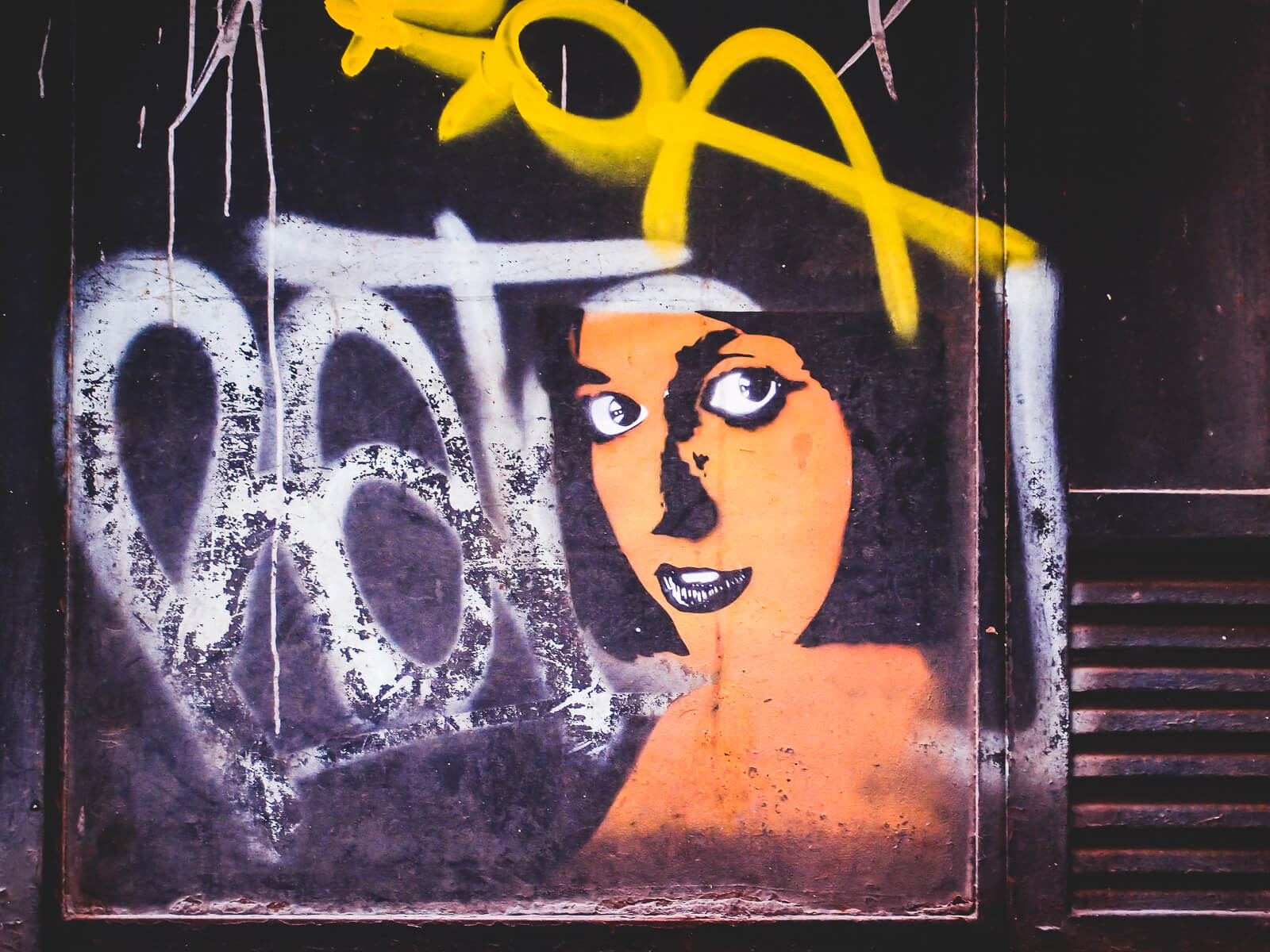 Barcelona Street Photography, orange face woman, street art stencil