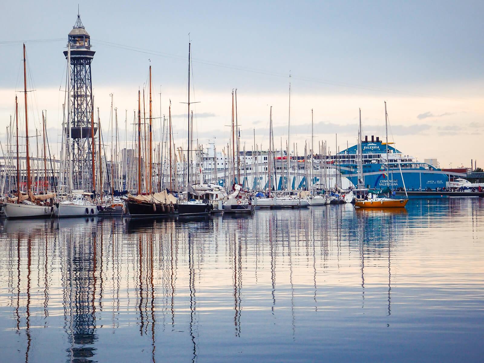 Barcelona Street Photography, calm water, mast pole reflexions, yacht port