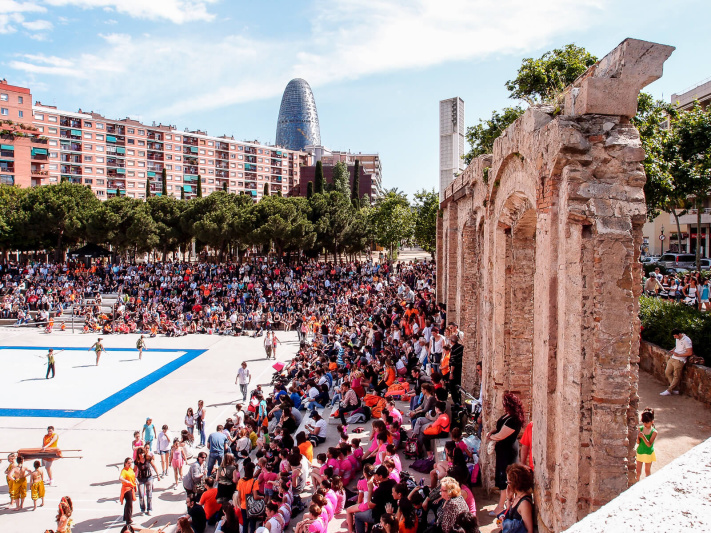 Barcelona Street Photography, Parc del Clot buildings, antique arches ruins, children sport event spectators, torre agbar