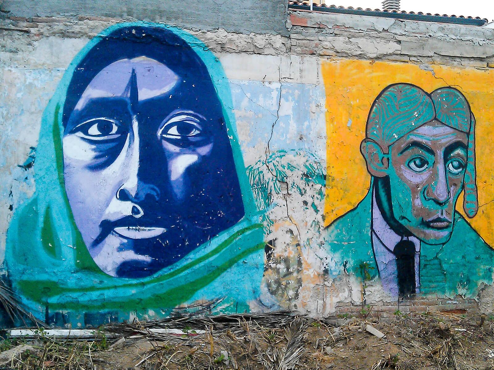 Barcelona Street Photography, blue face woman, green headscarf, street art mural