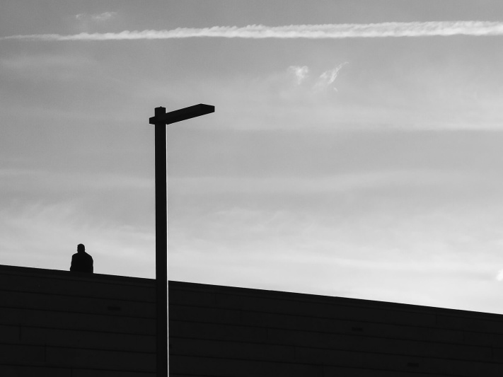 Barcelona, black and white, lonely man, outdoor stairs, silhouette sitting, street lamp, urban melancholy architecture