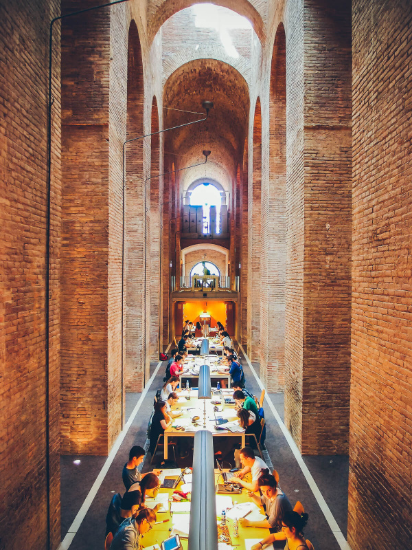 Barcelona, high brick walls, les aigues library, students working, water reservoir