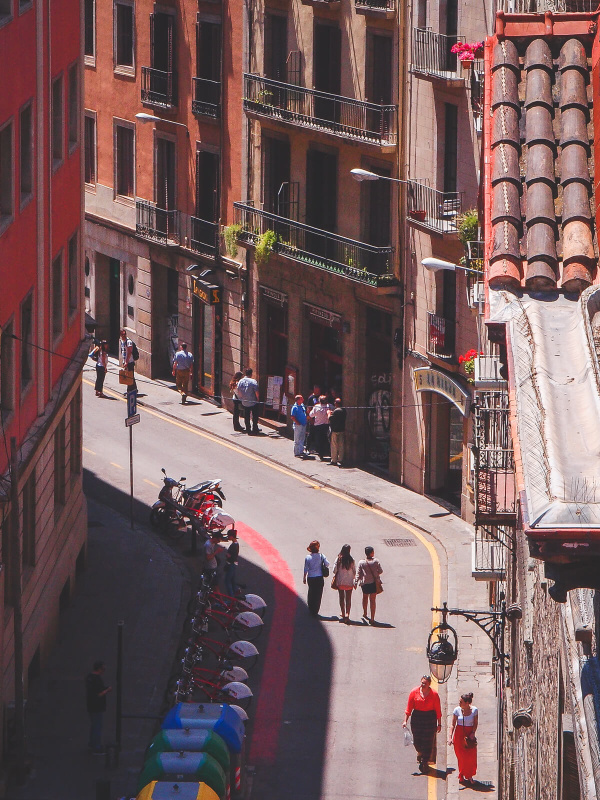 Barcelona, narrow alley streets, old town, pedestriants walking, streetlife