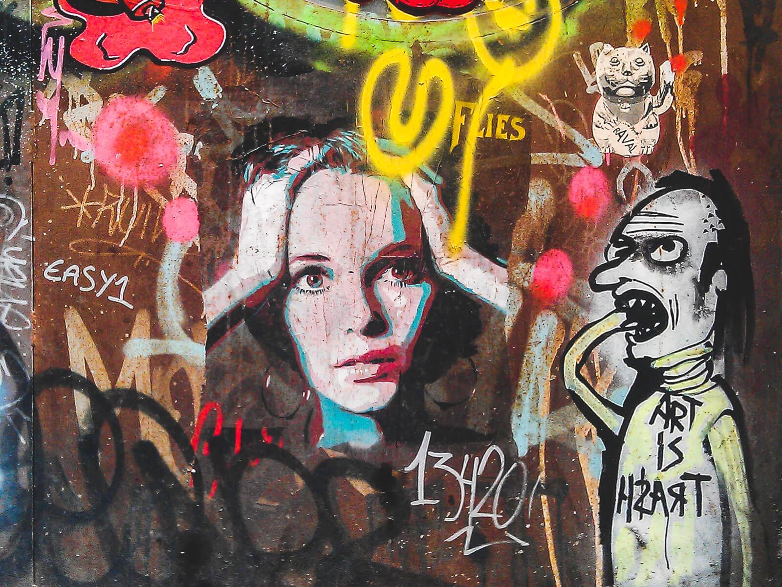 Barcelona Street Photography, art is trash, hands holding head, street art stencil