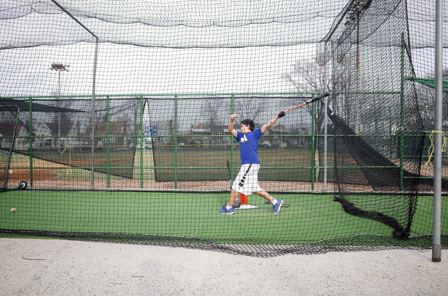 Hitting a Baseball inside the net - Exif Data: 1/250sec - f/5.6 - ISO-400