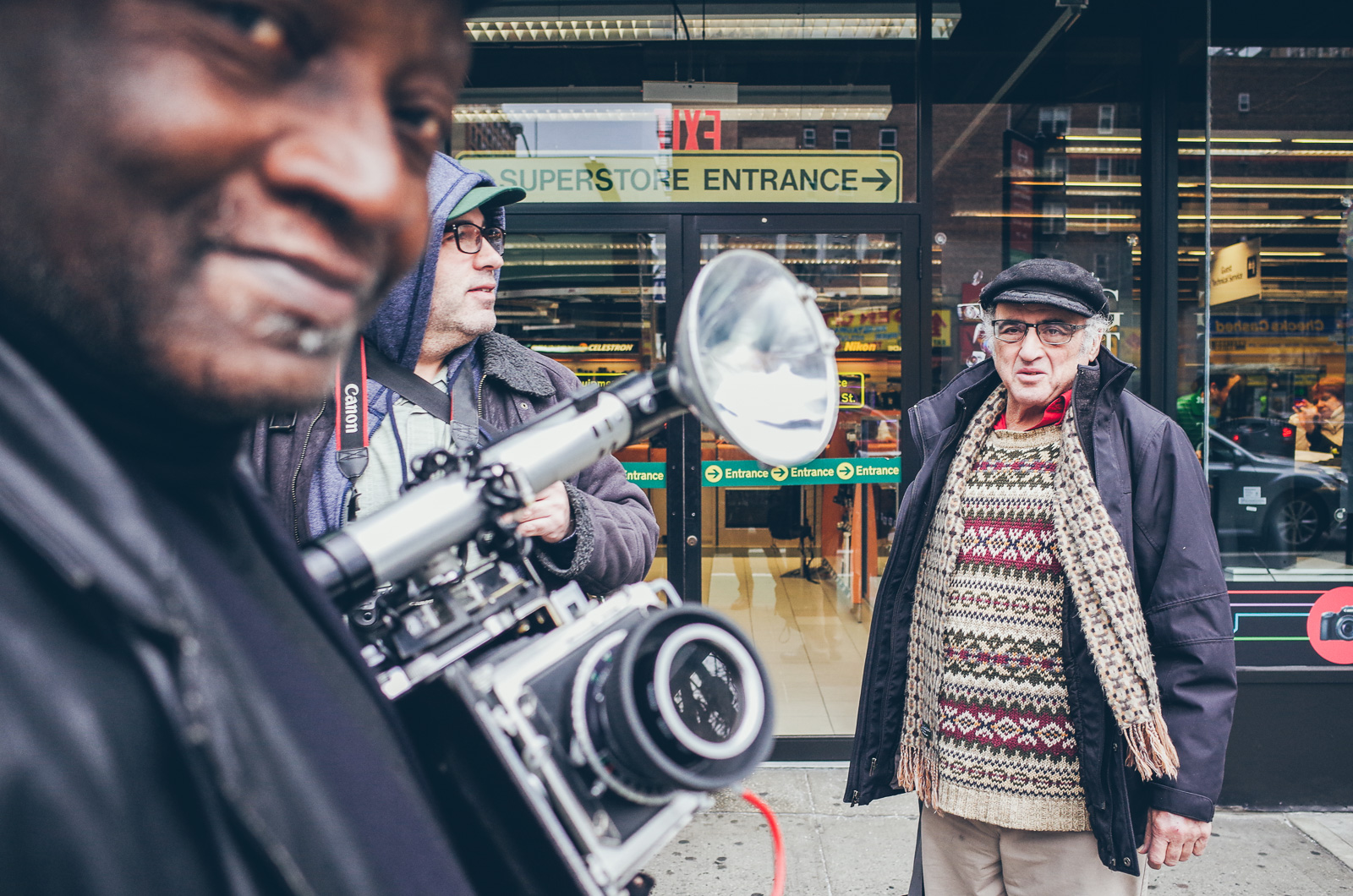 Louis Mendes with Camera in front of the B&H Stor, New York City, 2016