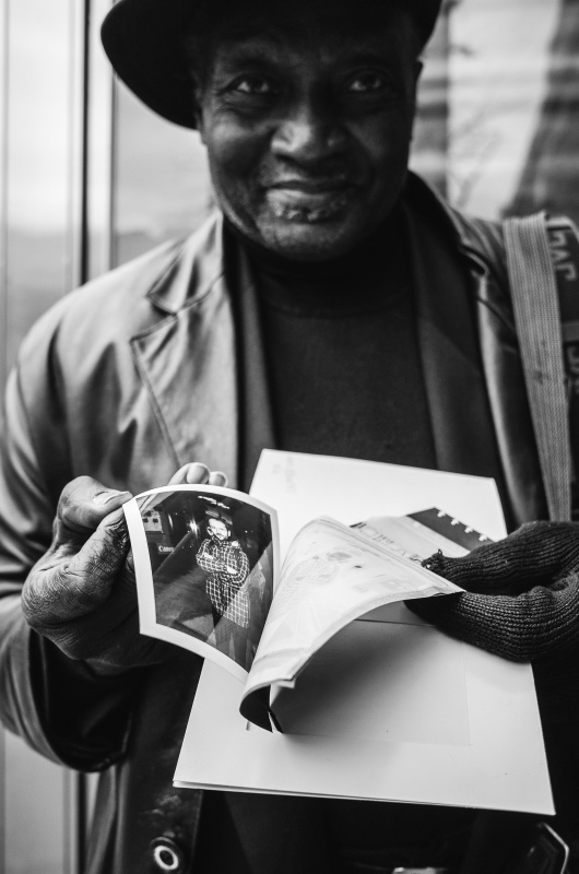 Mr Louis showing me his finished Polaroid picture - Exif Data: 1/200sec - f/2.8 - ISO-140