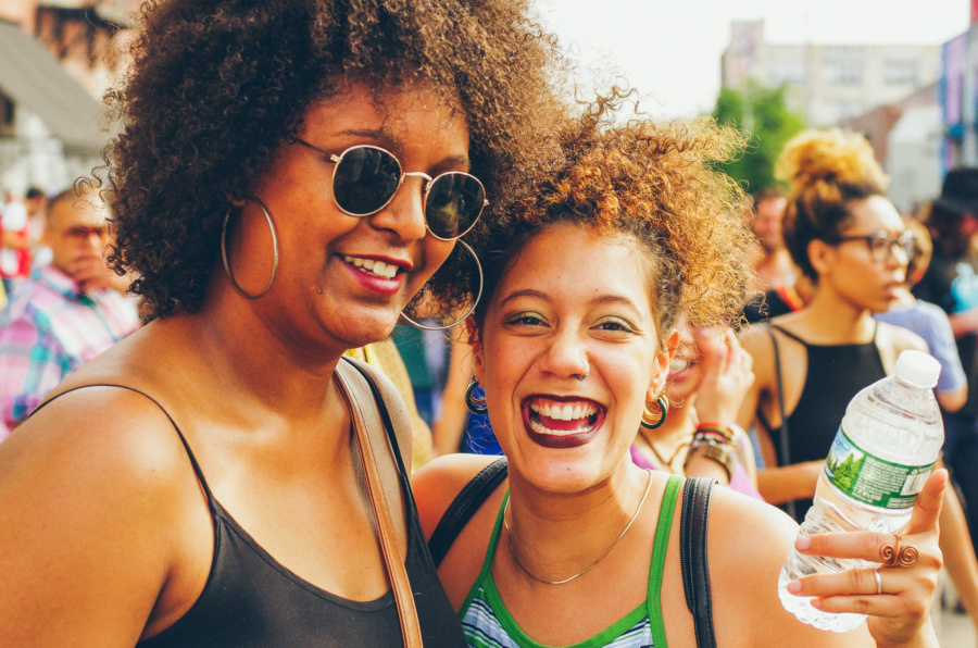 Two friends smiling on the Bushwick Collective Block Party 2016