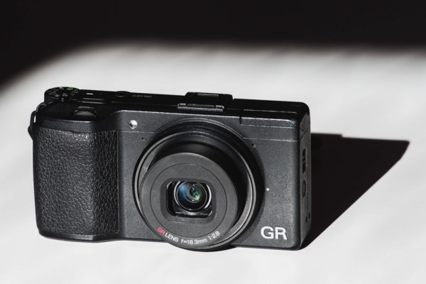Powered On Ricoh GR smallest lightest fixed prime lens camera with APS-C sensor